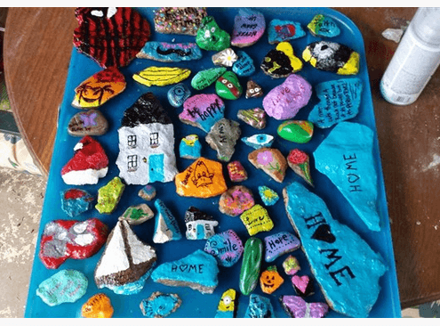 An array of rocks that have been painted with messages