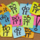fighting procrastination concept - do it phrase on color sticky notes posted on a cork bulletin board