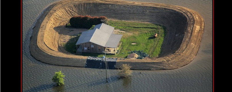 The ability to take care of yourself in the midst of overwhelming odds. A house with a berm all around it in the middle of a lake
