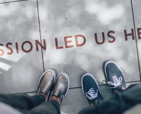 Passion led us here printed on a pavement.